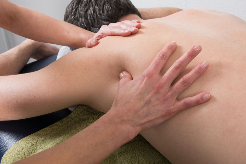 48762483 - close-up of person receiving shiatsu treatment from a therapist